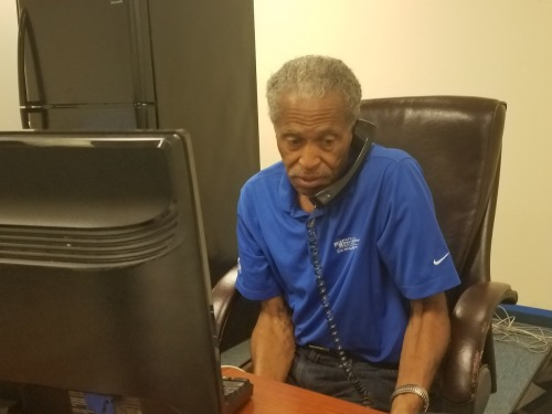 Bob Ross, president of the Prince George's County NAACP branch, answers the phone at the branch office in Largo. (William J. Ford/The Washington Informer)