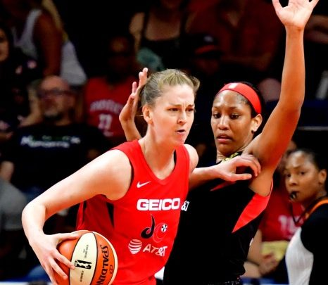 Washington Mystics forward Emma Meesseman posts up Las Vegas Aces forward A'ja Wilson during the Aces' 85-81 win at Entertainment and Sports Arena in D.C. on July 13. (John De Freitas/The Washington Informer)