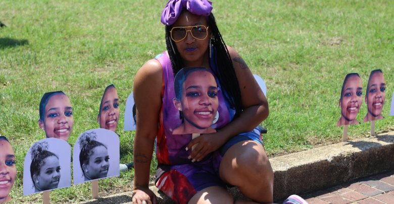 Queen Afi, pictured with a cut-out of her deceased daughter Smiley's face, at an annual cookout and celebration of love, life, laughter and legacy in honor of the 19-year-old mother of one. (Courtesy photo)