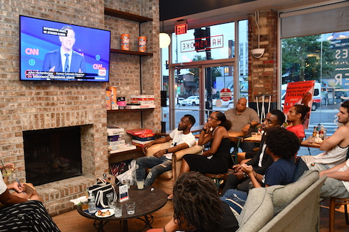 Photo of Millennials Listen Intently as Candidates Debate Health Care