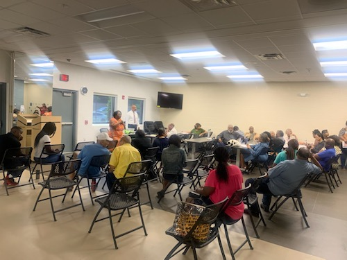 Prince George's County residents discuss their disapproval of a proposed logistics center during a community meeting at the newly constructed Peppermill Community Center in Hyattsville on July 27. (Anthony Tilghman/The Washington Informer)