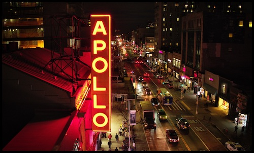 The famed Apollo Theater's neon sign shines over 125th Street in New York's Harlem neighborhood. (Courtesy of HBO via AFI Docs Film Festival)