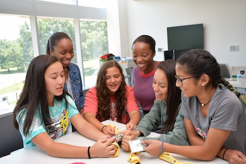 Twin sisters Mikaila Esuke (center with striped shirt) and Alexis Esuke (left in jean jacket) chat with students during the CompSciConnect summer camp at the University of Maryland in College Park on June 28. (Anthony Tilghman/The Washington Informer)