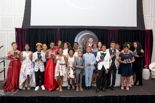 Youth honorees from across the nation are presented with awards by Gabrielle Jordan at the ExCEL Honors 2019 fala and fundraiser on June 21. (Brigette Squire/The Washington Informer)