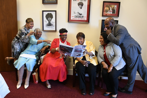 Rep. Eddie Bernice Johnson (third from right) reads The Washington Informer with friends. (Roy Lewis/The Washington Informer)