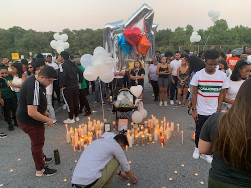 A candlelight vigil is held on July 12 at Parkdale High School in Riverdale, Md., for Morgan State University student and Parkdale alumnus Manuel Luis Jr., 19, who was fatally shot outside his Baltimore apartment the previous day. (Hamil R. Harris/The Washington Informer)