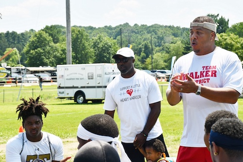 Maryland Del. Jay Walker (right) chats with high school football players alongside former NFL player and Fort Washington native Brian Westbrook during Family Fun Day at Tucker Road Athletic Complex in Fort Washington on July 27. Players from Oxon High, Potomac and Friendly high schools participated in a friendly seven-on-seven competition. (Anthony Tilghman/The Washington Informer)