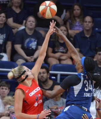 Washington Mystics forward Elena Delle Donne (left) blocks a shot by Minnesota Lynx center Sylvia Fowles during the Mystics' 101-78 victory at the Entertainment and Sports Arena in southeast D.C. on Aug. 11. (John E. De Freitas/The Washington Informer)