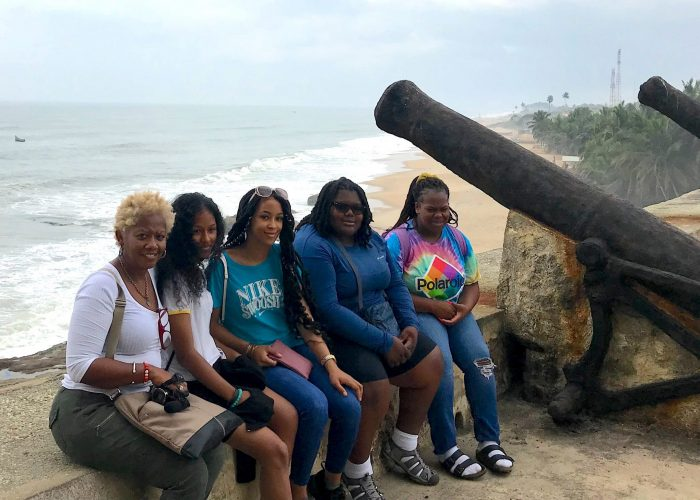 Wanda Lockridge, president of the William O. Lockridge Community Foundation, (l) at Cape Coast Castle in Ghana with D.C. students from Wards 7 and 8, sponsored the nonprofit on their first trip to Africa, specifically to Ghana, including (2nd l-r) Taleyah Evans, Jamerah Brown and Tatiana Robinson. Also pictured is Myla Brown of Baltimore, Md.