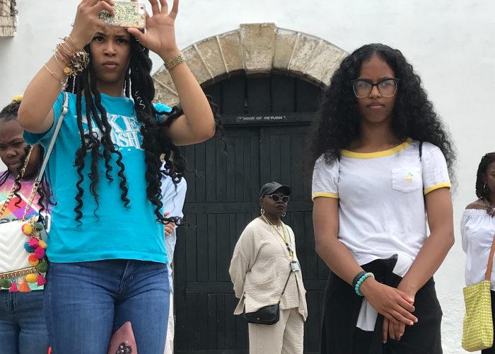 "D.C. high school students Jamerah Bowen (l) and Taleyah Evans take in the vast Atlantic Ocean in front of them after passing through the Door of No Return at Cape Coast Castle in Ghana where Africans were held as cargo on the Transatlantic Slave Trade over 400 years ago. Outside the door is a sign noting ""Door of Return"" signifying the Ghanaian government's initiative welcoming home Africans living around the world."
