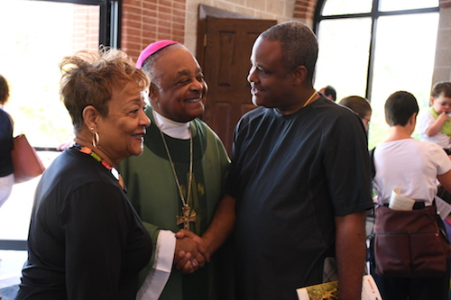 Archbishop Wilton D. Gregory greets congregants after Mass at St. Jane Frances de Chantal Church in Bethesda, Maryland, on July 28. (Roy Lewis/The Washington Informer)