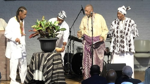 A libation conducted by Nana Kwabena Brown (center) during the celebration of the life and legacy of Ron Clark at the Westminster Presbyterian Church in southwest D.C. on Aug. 10. (Courtesy photo)