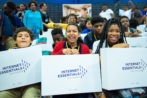 Students are surprised with free laptops from Comcast's Internet Essentials program. (Courtesy of Comcast internet Essentials)