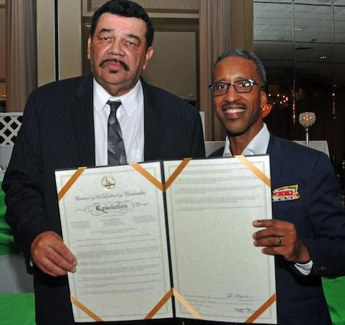 Aron C. Webster (left), Kingman Boys and Girls executive director, and D.C. Councilman Kenyan McDuffie (D-Ward 5) hold proclamations from the office of D.C. Del. Eleanor Holmes Norton, Ward 5 and the Mayor's Office in honor of the organization's 50th anniversary. (Courtesy of Milton Williams)