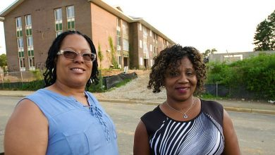 Cynthia Eaglin and Rufaro Jenkins in front of their former home at Parkway Overlook Apartments in Washington, D.C. (Courtesy of NNPA Newswire)