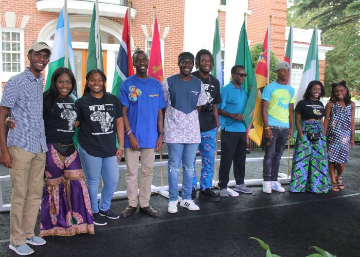 Hampton University and local high school students present flags from West African countries involved in the trans-Atlantic slave trade. (DR Barnes/The Washington Informer)