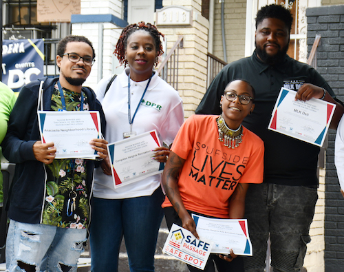 Businesses along the Martin Luther King corridor in Southeast were recognized as Safe Spots at the Office of the Deputy Mayor for Education's Safe Passage Program kickoff on Aug. 23. (Anthony Tilghman/The Washington Informer)