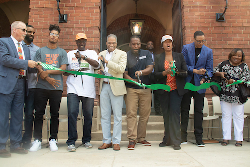 From right: Coolidge Senior High School Principal Samantha Bright, D.C. Public Schools Chancellor Lewis Ferebee, Mayor Muriel Bowser, D.C. Department of General Services Director Keith Anderson, Ward 4 Council member Brandon Todd and Coolidge Alumna President Terry Goings join Ward 4 residents and supporters to cut the ribbon on the newly renovated high school and adjacent Ida B. Wells Middle School in Northwest on Aug. 24. (Shevry Lassiter/The Washington Informer)