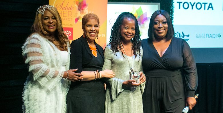 Washington Informer Publisher Denise Rolark Barnes (second from right) is honored at the Café Mocha's 2019 Salute Her: Beauty of Diversity Awards program on Aug. 22, where she was presented with the Trailblazer Award by (from left) Yo-Yo, Sheila Eldridge and Loni Love for making a difference in her community. (Shevry Lassiter/The Washington Informer)