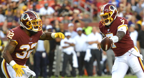 Washington Redskins quarterback Dwayne Haskins hands the ball off to running back Samaje Perine during Washington's 20-7 preseason loss to the Baltimore Ravens at FedEx Field in Landover, Md., on Aug. 29. (John E. De Freitas/The Washington Informer)