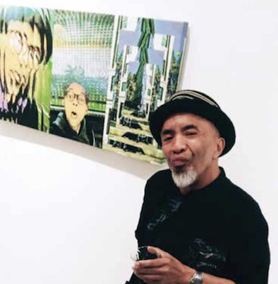 "Artist Remy T with his photographic print, ""Precious One,"" at the opening of ""Just Do It: Friends of Michael Platt"" at the Honfleur Gallery (Courtesy of BAMBAM)"