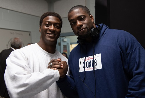 """Actor Aldis Hodge (left) and Brian Banks on the set of Tom Shadyac's """"Brian Banks"""" (Courtesy of Forbes)"""