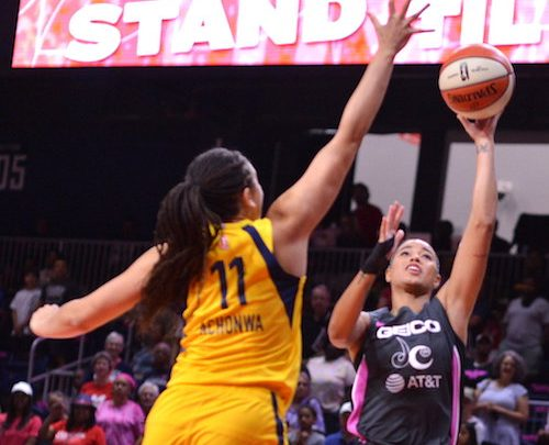 Washington Mystics guard Natasha Cloud shoots over Indiana Fever center Natalie Achonwa during the Mystics' 107-68 win at the Entertainment and Sports Arena in southeast D.C. on Aug. 18. (John E. De Freitas/The Washington Informer)