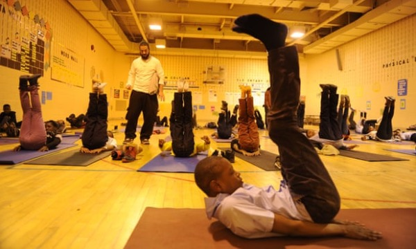 Students at Robert W. Coleman Elementary School participate in breathing exercises during a Holistic Life Foundation program. (Colby Ware/Open Society Institute-Baltimore)