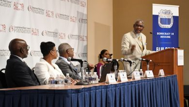 Rep. Gregory Meeks (D-N.Y.) speaks at the State of Housing in Black America issue forum while panelists Maurice Jourdain-Earl, Nikitra Bailey and Mark Alston look on. (Roy Lewis/The Washington Informer)