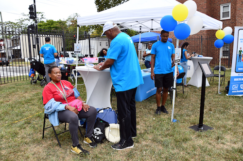 Ward 7 resident Renee Powell participates in a health screening during Community Day in Congress Heights on Sept. 14. (Anthony Tilghman/The Washington Informer)