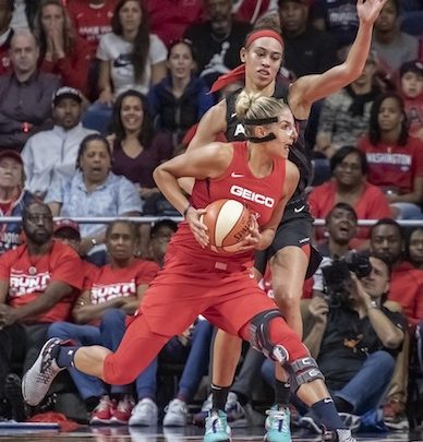 Washington Mystics forward Elena Delle Donne goes to the basket against Las Vegas forward Dearica Hamby in the first half of the Mystics' 103-91 win in Game 2 of the WNBA semifinals series at the Entertainment and Sports Arena in D.C. on Sept. 19. (Photo by Yusuf Abdullah)