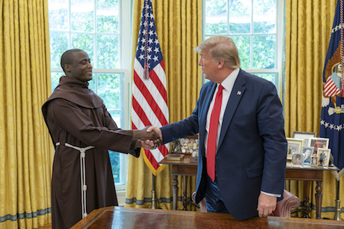 President Donald Trump greets Global Teacher Prize recipient Peter Tabichi of Kenya in the Oval Office of the White House on Sept. 16, 2019. (Official White House photo by Joyce N. Boghosian)