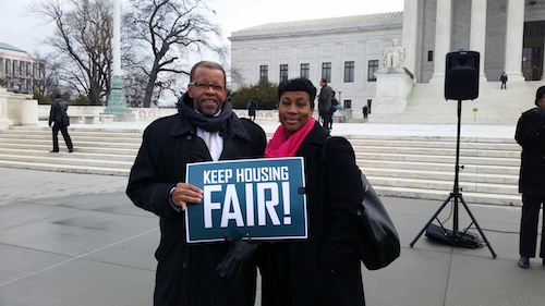 Keith Corbett and Nikitra Bailey of CRL with Fair Housing Sign after testifying on Capitol Hill