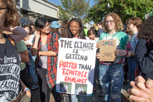 Samia Abdur-Rahim (center), a 10th grader at Northwood High School in Silver Spring, Maryland, linked with other students and walked out of class Sept. 20 to protest climate change. (Shevry Lassiter/The Washington Informer)