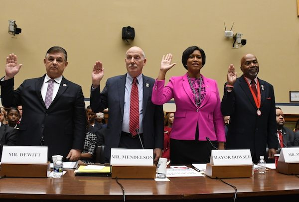 From left: D.C. Chief Financial Officer Jeffrey DeWitt, D.C. Council Chairman Phil Mendelson (D), Mayor Muriel Bowser (D) and District veteran Kerwin Miller are sworn in to testify at Sept. 19 hearing on Capitol Hill for the District to become the nation's 51st state. (Roy Lewis/The Washington Informer)