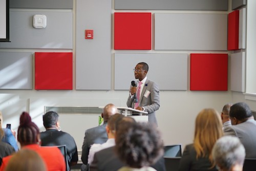 "Dr. Ernest Chrappah, director of DCRA, speaks to the attendees of the ""Food for Thought"" event in Southeast on Sept. 18. (Courtesy of DCRA)"