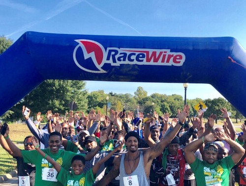Participants raise their arms during the National African American Male Wellness Walk at Anacostia Park in Southeast on Sept. 21. (Courtesy of Joshua Ross)