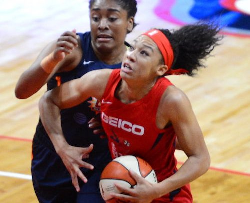 Washington Mystics guard Aerial Powers attempts to drive past Connecticut Sun forward Morgan Tuck in the first half of the Mystics' 95-86 victory in Game 1 of the WNBA finals at Entertainment and Sports Arena in southeast D.C. on Sept. 29. (John E. De Freitas/The Washington Informer)