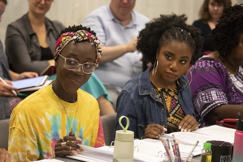 "Moriamo Temidayo Akibu Gifty (left) and Debora Crabbe, cast members in Round House Theatre production of ""School Girls; or the African Mean Girls Play"" take part in a rehearsal. (Kaley Etzkorn/Round House Theatre)"