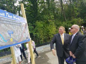 Maryland Transportation Secretary Pete K. Rahn (left) reviews the Purple Line light-rail plan with Gov. Larry Hogan in Lanham on Sept. 5. (William J. Ford/The Washington Informer)