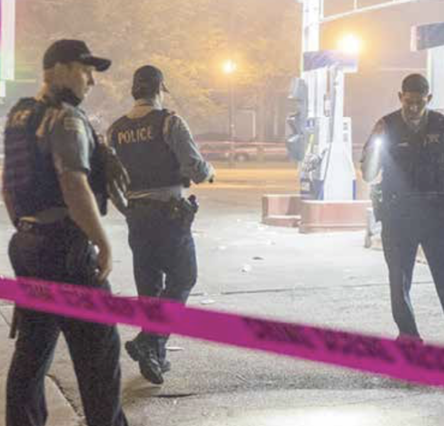 Police officers assess the damage from a recent mass shooting in Texas. (Courtesy photo)