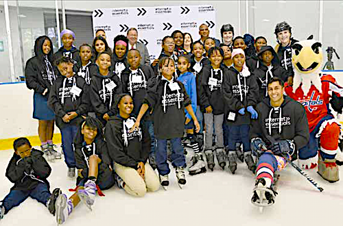 David L. Cohen, senior executive vice president and chief diversity officer of Comcast Corporation joins in a group shot at the Internet Essentials fall tour at Fort Dupont Ice Skating Rink in southeast D.C. on Sept. 10. (Anthony Tilghman/The Washington Informer)