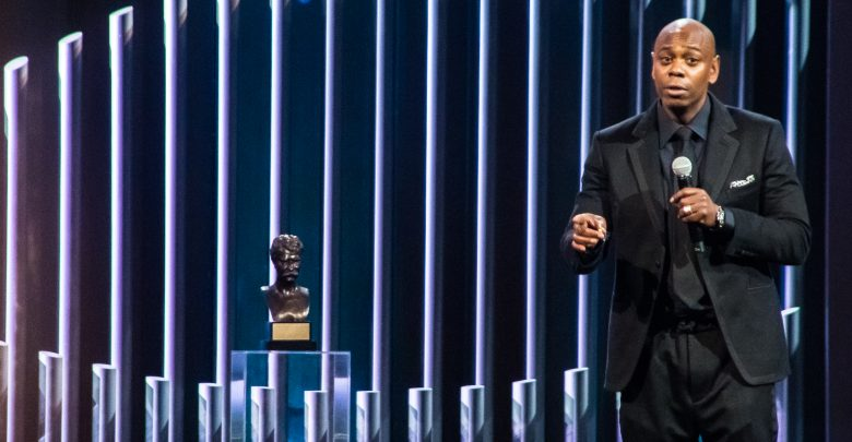 Comedian Dave Chappelle accepts the Mark Twain Prize for American Humor on Oct. 27 at the John F. Kennedy Center for the Performing Arts. The show will air on PBS in January. (Shevry Lassiter/The Washington Informer)