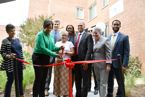 On the morning of Sept. 26, D.C. Mayor Muriel Bowser (D), Ward 4 Council member Brandon Todd (D), and others celebrated the preservation of affordable housing at a ribbon-cutting ceremony for the newly renovated Fort Stevens Place. (Anthony Tilghman/The Washington Informer)