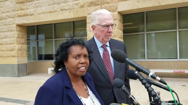 Former Maryland Del. Tawanna Gaines, joined by her attorney, William Brennan Jr., speaks to reporters on Oct. 17 after she was arraigned in U.S. District Court in Greenbelt on a federal wire fraud charge. (William J. Ford/The Washington Informer)