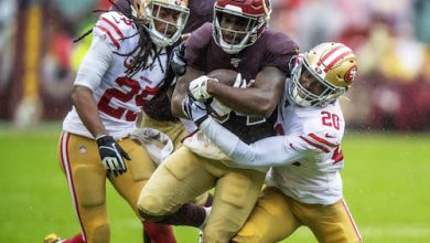 Washington Redskins running back Wendell Smallwood is tackled by San Francisco 49ers cornerback Jimmie Ward during the 49ers' 9-0 win at FedEx Field in Landover, Md., on Oct. 20. (Photo by Yusuf Abdullah)