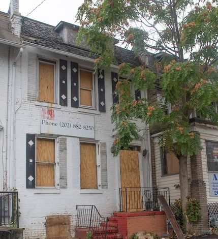 A fire at 708 Kennedy Street NW on Aug. 18 that killed a man and an elementary school student revealed lapses in the Department of Consumer and Regulatory Affairs' building inspection process. (Shevry Lassiter/The Washington Informer)