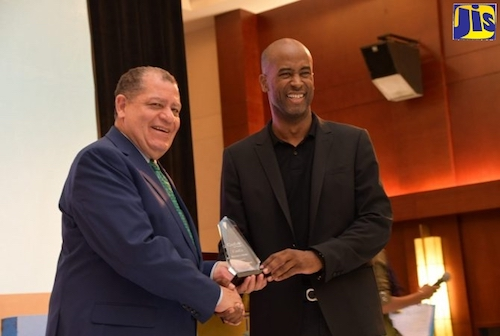 e Hon. Audley Shaw (left), Minister of Industry, Commerce, Agriculture and Fisheries, accepts the Maverick Award from Founder of the CanEx Business Conference and Expo, Douglas Gordon, during the opening ceremony of the event at the Montego Bay Convention Centre on September 26. (Courtesy photo/Serena Grant)