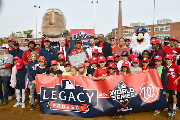Mayor Muriel Bowser, D.C. Council member Charles Allen (Ward 6), and Lewis D. Ferebee, chancellor of DC Public Schools, join MLB and the Washington Nationals at Payne Elementary School in partnership with Capitol Hill Little League (CHLL), Oct. 25. School activities include netting upkeep, debris removal, and cosmetic repairs. (Anthony Tilghman/The Washington Informer)