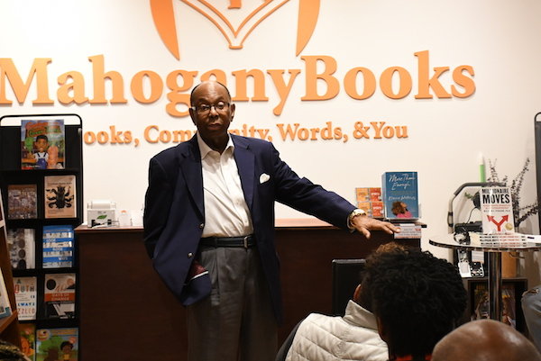 Multimillionaire entrepreneur William Pickard chats with Mahogany Books co-owner Derrick Young. (Roy Lewis/The Washington Informer)